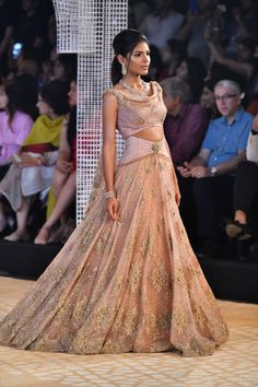 Tarun Tahiliani ICW 2018 collection has phenomenal red bridal lehengas along with fusion wear sarees. Also see under lakh Tarun Tahiliani Lehengas. Indian Lehenga, Lehenga Choli, Cape Lehenga, Floral Lehenga, Saree Gown, Sarees, Indian Dresses, Indian Outfits, Indian Attire