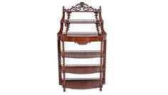 An exceptional late Victorian veneered walnut 'Whatnot' of serpentine outline and pierced carved crest gallery top. The spiral rosewood twist pillars hold the five tiers, one of which is a hidden drawer.                                                                                                                 C.1850