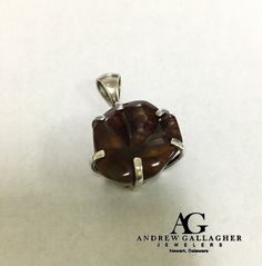 50% OFF! Sterling Silver Fire Agate Pendant (24.2 carats) (No Chain) Original Retail Price: $118.00 SALE PRICE: $59.00. Call Andrew Gallagher Jewelers at 302-368-3380 for more information. We SHIP!! | DETAILS:  Pendant dimensions are 34mm x 18mm | #50OffJewelryCase