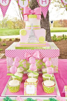 Preppy Tennis party! Love the tennis ball cake pops! Love the paper cover box as a cake stand elevated above the cupcakes and of course the pink!