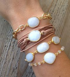 Faceted, white stone is bezel set in gold vermeil. A thick gold plated chain extends from the stone. Bracelet is finished off by a gold plated toggle clasp.