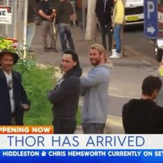 Tom and Chris wave to Brisbane newscaster.