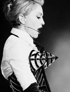 """Madonna in the cage bra performing """"Vogue"""" in Madonna Vogue, Madonna Fashion, Lady Madonna, Madonna Live, Madonna Art, Agnes Moorehead, Guy Ritchie, Sean Penn, Jane Russell"""