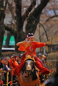 """Women Warriors 5 (by Tony Jarry) """"Warrior women"""" Series - The northern part of Japan is the place where the majority of archers are women. This event is a woman's only event. They ride and shoot at fixed targets. Towada has the most women archers in Japan. This City also has the most women archers in the country. Very traditional sport."""