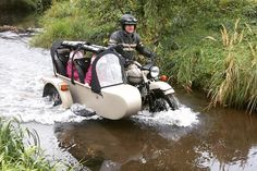 """""""Water crossing with custom extended sidecar. Seats 2 kids and includes custom windshield and roll cage.  Kids wanted to ride in a rocket ship, wish…"""""""