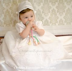 This sweet christening gown for girls has pretty embroidery over organza. Fully lined. Available at Christian Expressions of Rhode Island. Quality made in the USA Christening Gowns For Girls, Boy Christening Outfit, Baptism Outfit, Baptism Gown, Baby Baptism, Expressions Photography, Baby Hats, Flower Girl Dresses, Christian