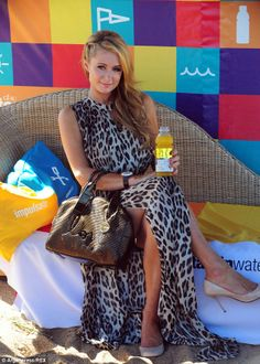 SPOTTED: At the beach, Paris Hilton looking hot in this #leopardprint beach dress