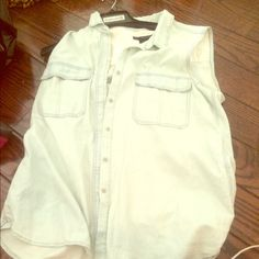 Calvin cline denim button up Brand me w, never been worn tags still on . Button up Dennim. Cute with black pants Calvin Klein Tops Button Down Shirts