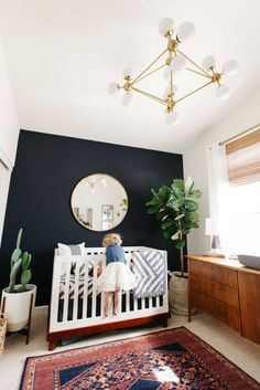 LEVIS NURSERY REVEAL 2019 a sister and brother moment // boy nursery with dark navy accent wall ornate rug fiddled fig tree bubble chandelier and mid-century credenza Decoration Inspiration, Nursery Inspiration, Decor Ideas, Decorating Ideas, Baby Boy Rooms, Baby Boy Nurseries, Unisex Baby Room, Modern Nurseries, Baby Cribs