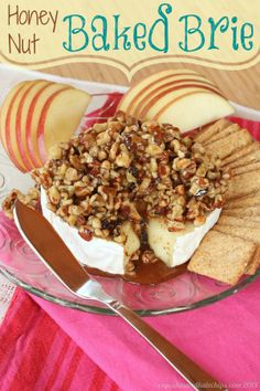 Honey Nut Baked Brie - my family's favorite appetizer. With ooey gooey cheese and lots of crackers and apple slices for dipping, it'll be a hit at any party| cupcakesandkalechips.com | gluten free