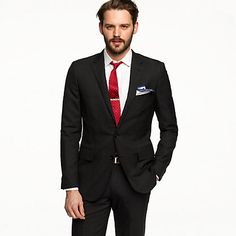 Two-button suit jacket + red tie