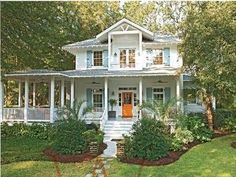 this house drove me nuts in BHG, the hallway/stairs were amazing! Love the white house, blue shutters, and ORANGE door.