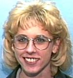 """Christine Lorraine Brock   Missing Since: 8/10/2000    Sex Female Race White   Age 34   Hgt 5'3 Wt 90   Hair Brown Eye Brown  Scar on tip of middle right finger, tattoo of """"sun, moon and stars"""" on right hip, brown birthmark on back of leg. Wearing: T-shirt and shorts. Last seen at Asian Garden Restaurant on Elm Rd. talking on payphone.   Case #: 00-24077  WARREN POLICE DEPARTMENT   1-330-841-2536"""