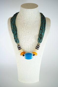 A personal favorite from my Etsy shop https://www.etsy.com/listing/545466826/turquoise-multistrand-necklace-bone-and