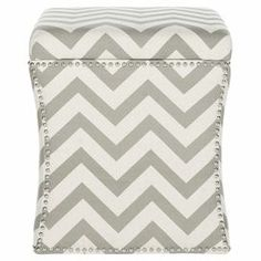 """Contoured storage ottoman with a chevron motif and nailhead trim.  Product: Storage ottomanConstruction Material: PlywoodColor: Grey and whiteDimensions:  20.5"""" H x 18"""" W x 18"""" D"""