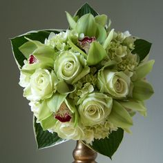 Green hydrangea, roses and cymbidium orchids.  I like this for the bridesmaids bouquets- minus the leaves the border the bouquet.
