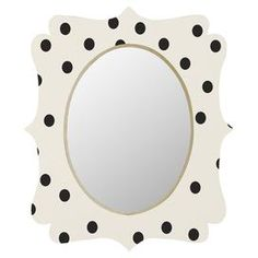 this charming Baltic birch wood wall mirror, showcasing a quatrefoil-inspired frame and a lovely polka dot motif. Made in the USA.