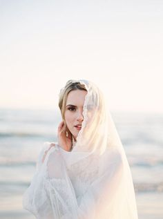 salty waves and setting suns for this fine art bride