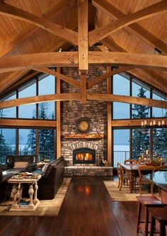 I love when windows flank a big fireplace and open you up to the outdoors. This timber cabin is gorgeous.