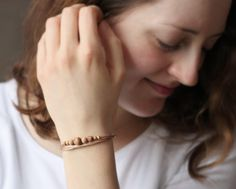 Delicate woody bracelet from Claudia with our Gold frosted spacers 2010 https://www.etsy.com/listing/451193404/2010gold-bead-spacers-4mm-round-beads?ga_search_query=2010&ref=shop_items_search_1 and https://en.dawanda.com/product/102774903-201020gold-bead-spacers-4mm-round-beads