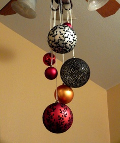 Christmas ornaments hanging from ceiling in red gold and for Christmas ceiling decorations