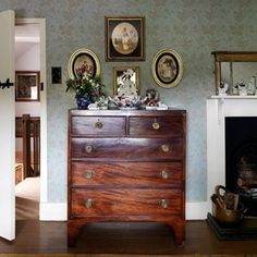Emma Burns of Colefax and Fowler has created a pretty tableau with oval frames and ornaments over this chest of drawers