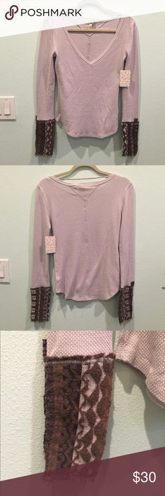 Free People Top Very stylish yet comfy lavender top! It has gorgeous tapestry mesh type cuffs on the sleeves. The neckline has a deep v-neck. Free People Tops Tees - Long Sleeve