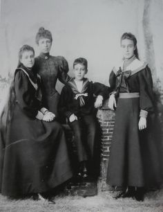 María Cristina of Austria, Queen Regent of Spain, with her three children, the Infanta Mercedes, Princess of Asturias, the Infanta María Teresa and Alfonso XIII, the underage King of Spain.