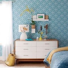 """Love the look of wallpaper but not the commitment? """"Endless Circles Lattice"""" stencil from Royal Design Studio would jazz up a room and could easily be painted over later if you wanted a change."""