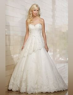 Ball gown wedding dress with tiered skirt features floral lace and  beautiful strapless top. Exclusive designer ball gown wedding dresses by  Essense of ... d52fc27a4569