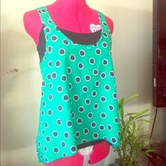 Polka dot top Super cute green sleeveless top with navy blue polka dots, hi low hem, perfect for layering. Excellent condition DNA couture Tops