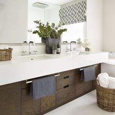 Love the idea of the basket with towels. Could use the current snack bin for this.