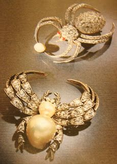 Paulding Farnham: Tiffany's Master Jeweler designed these Diamond and pearl arachnid brooch pins. The spider at top has rubies for eyes.