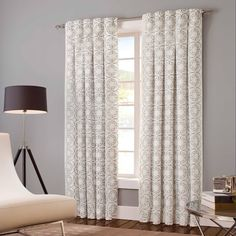 Cream panel drapes with grey scrollwork design
