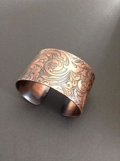 Large Etched Copper Floral Pattern Cuff by Buffalo Craft Company. American Made. See the artist's work at the 2014 Buyers Market of American Craft, Philadelphia, PA. January 18-21, 2014. americanmadeshow.com