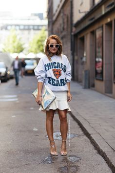 sweatshirt, tail skirt, and mirrored clutch. so effortless yet dressy. love this