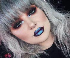 Bold alternative makeup  smokey eye and blue metallic  lips