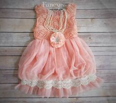 Perfect Shabby Chic look!  This dress is adorable! It is made with a coral/pink fabric , and an ivory lace trim that is truly vintage inspired! It