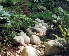 Use groupings of boulders like this to emphasize a meander, even in a relatively straight channel. The ferns and grasses look great - find some that are drought-tolerant or shaded by grasses on bank above.