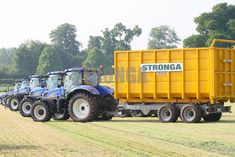 Lined up and ready for grass silage harvest   #stronga #newholland #trailer #tractor #grass #silage #harvest #agriculture #agriculturalmachinery #hooklift #hookloader #farming #farmer