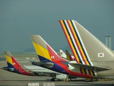 Old and new Asiana tails at Incheon