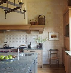 Tile, granite, mantle. Vail ski home by designer Yvonne Jacobs. Colorado Homes & Lifestyles.