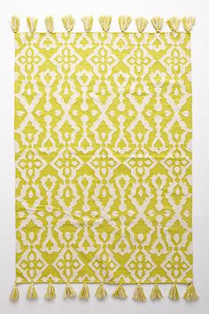 Throw Rugs are a perfect way to update any space. We love to layer colorful rugs over natural area rugs to add texture and depth to a space.  Tassled Chanda Rug, Antrhopologie