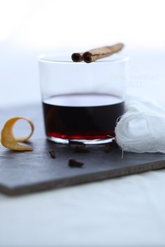 Glühwein is the German version of Mulled Wine:1 bottle of red wine;   ½ cup of white sugar; ½ cup of freshly squeezed orange juice; sliced peels of 1 orange; a few whole cloves;   2 cinnamon sticks or pieces; a few black peppercorns; Cognac or Grand Marnier to taste.