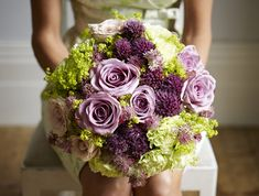 Lilac and soft pink roses are combined with mint green carnations, alliums, alchemilla mollis and astrantia.