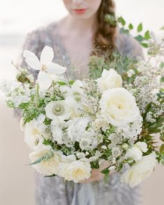 The most lush bouquet of whites and creams designed by the amazingly talented @laurasfloras recently featured on @weddingsparrow. .…
