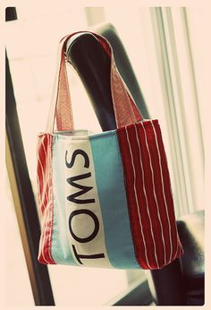"""TOMS Tote Bag DIY. """"I've gone through quite a few pairs of TOMS shoes, so I've got quite a few of these canvas drawstring bags hanging out. I don't use them for anything, but I've saved them with the intent on figuring out some kind of crafty use. Finally, here is my first project! A super easy lined tote with pockets."""""""