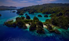 Remote islands of Raja Ampat in Indonesia by markyboy79. Have a great weekend :) Visit our Site: https://www.areagoods.com