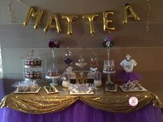 Purple and gold baby shower dessert table