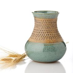Totally inspired by my cousin Steph's pottery (this isn't hers, but I liked the wheat next to it!).  She's taken a few courses and all of her work is composed of muted greens and browns like this one.  Never thought of taking a pottery course until now....